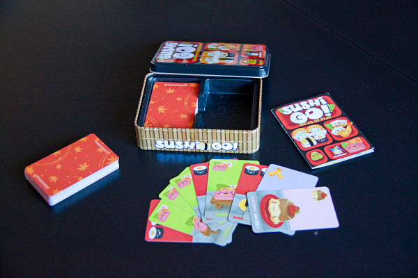 The box contains a deck of 108 cards and can be played on small tables.