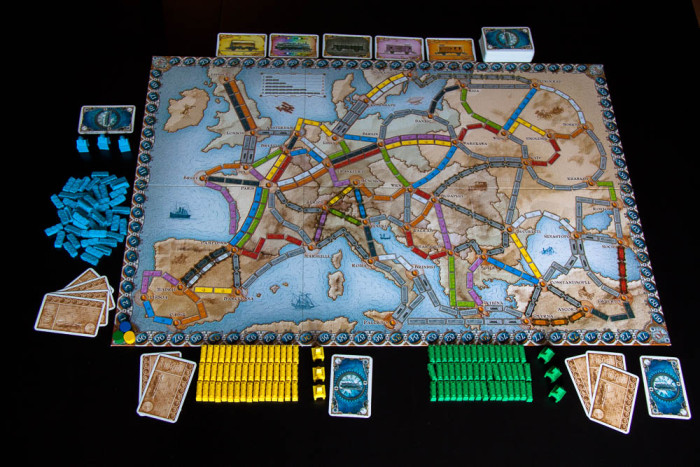 A game of Ticket to Ride: Europ set up for three players. Blue is messy.