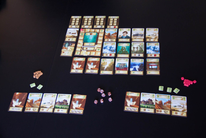 A two-player game of Artifacts Inc all set up to play.
