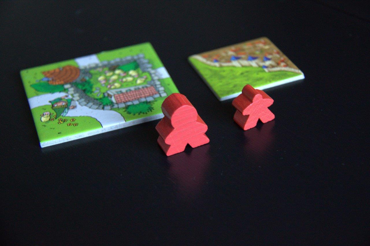 Comparing My First Carcassonne with its smaller big sibling.